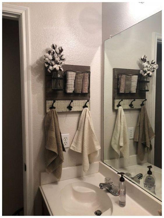 como organizar banheiro ganchos